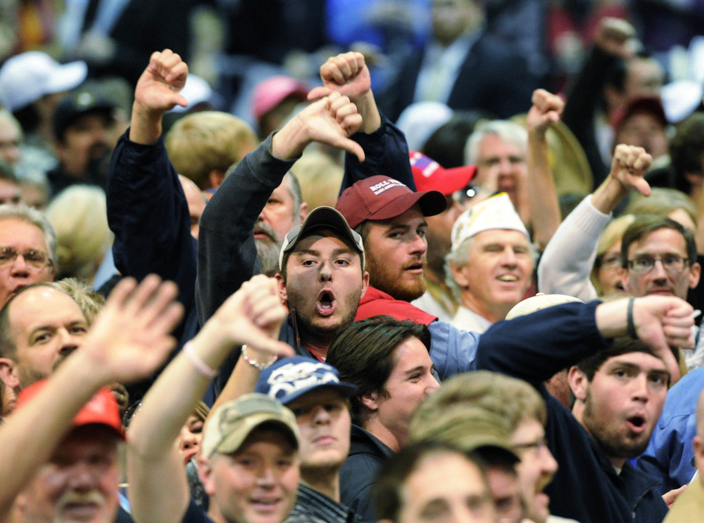 """FILE - In this Saturday, Nov. 21, 2015 file photo, Trump supporters """"boo"""" members of the media after a heckler was removed during a cam..."""