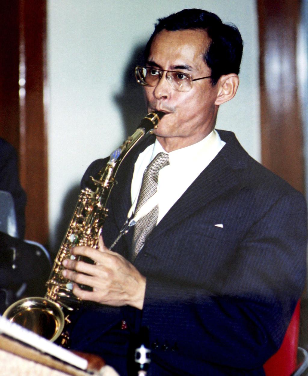 File  In This Undated Photo Released By Thailand Bureau Of The Royal  Household, King Bhumibol Adulyadej Plays A Saxophone In Bangkok