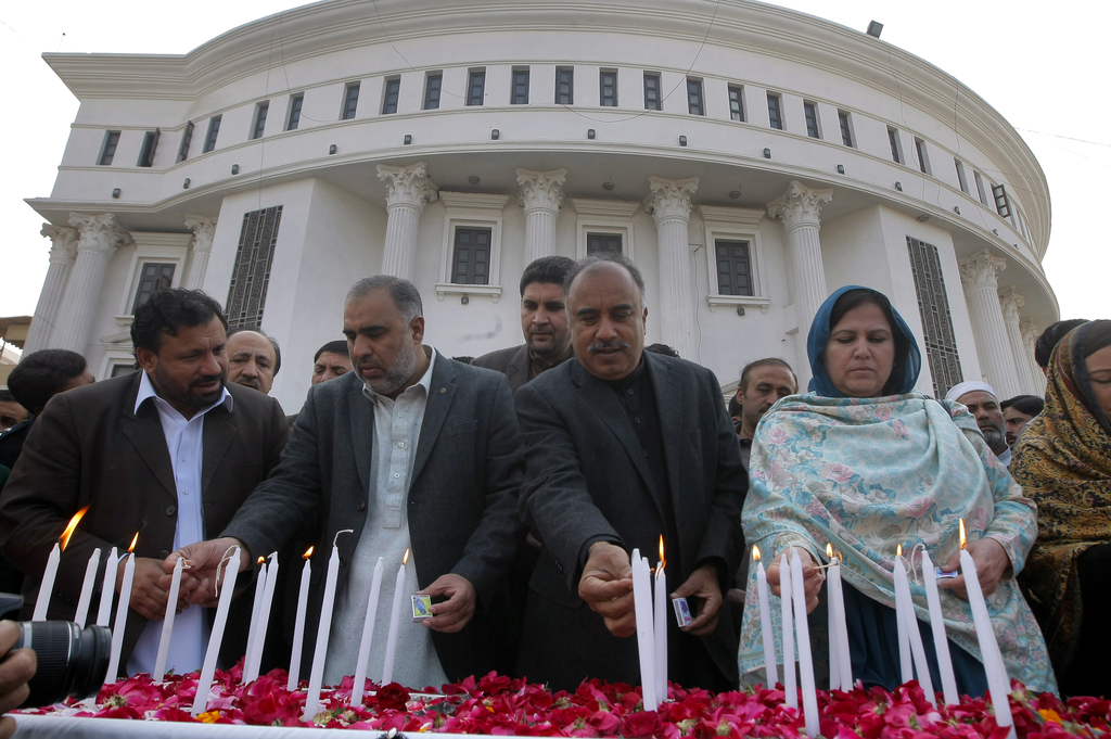 Stani Lawmakers From Provincial Khyber Pakhtunkhwa Embly Light Candle During A Ceremony To Mark Second Anniversary
