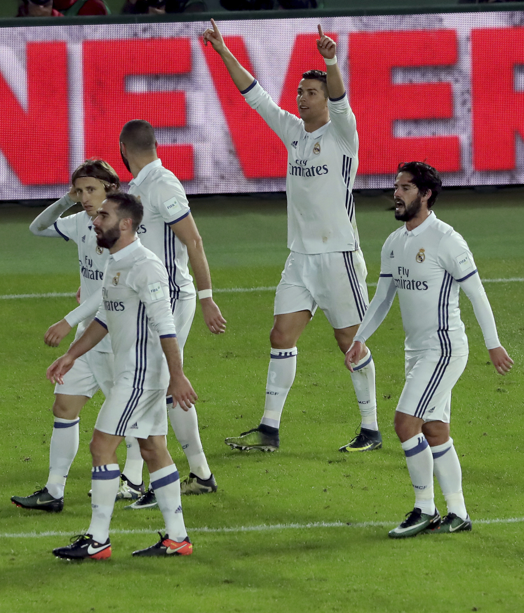 Real Madrid's Cristiano Ronaldo gestures after scoring his third goal against Kashima Antlers during the final of the FIFA Club World C...