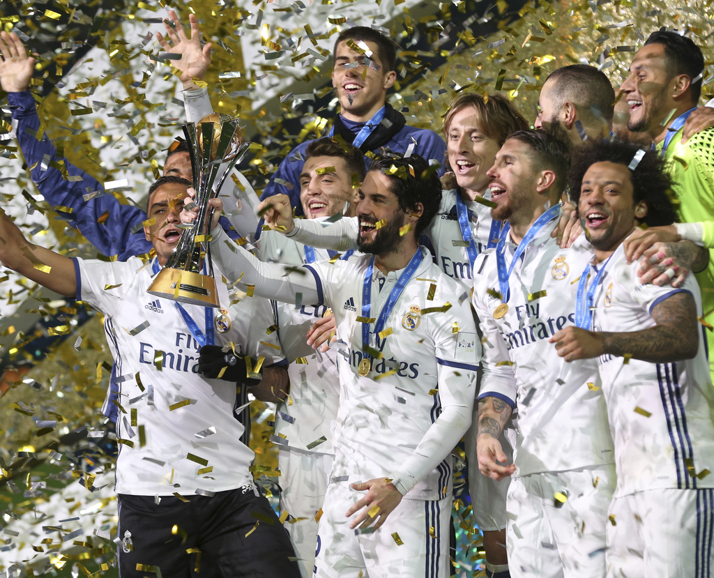 Real Madrid players celebrate on the podium after beating Kashima Antlers 4-2 to win the FIFA Club World Cup soccer tournament in Yokoh...