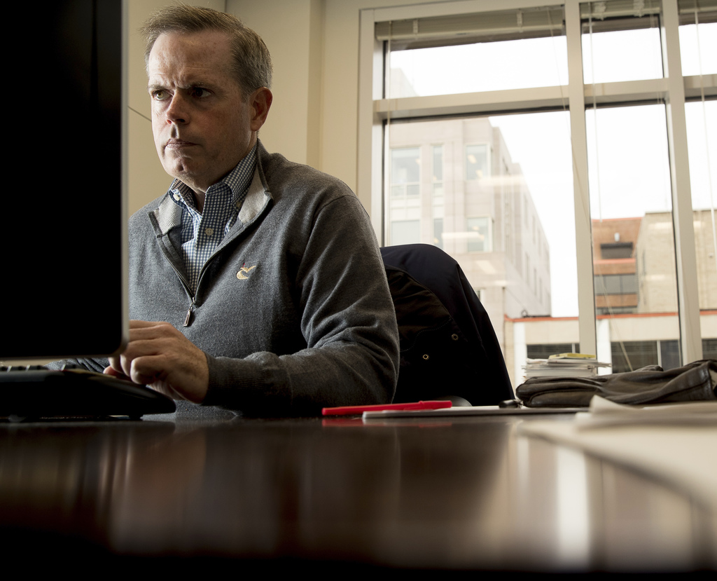 In this Friday, Dec. 16, 2016, photo, Keefe, Bruyette & Woods Managing Director Brian Gardner works at his desk, in Washington. A possi...