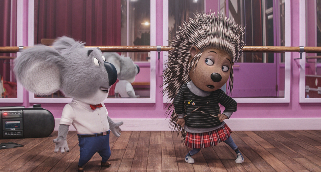 This image released by Universal Pictures shows Buster Moon, voiced by Matthew McConaughey, left, and Ash, voiced by Scarlett Johansson...