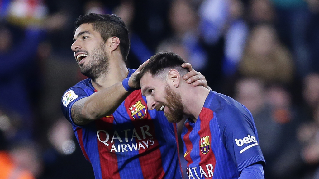 FC Barcelona's Luis Suarez, left, celebrates with his teammate Lionel Messi after scoring during the Spanish La Liga soccer match betwe...