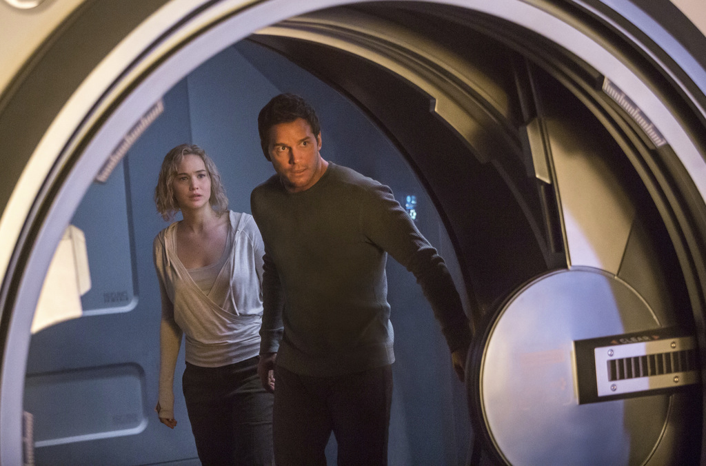 """This image released by Columbia Pictures, Jennifer Lawrence, left, and Chris Pratt in a scene from the film, Passengers."""" (Jaimie Trueb..."""