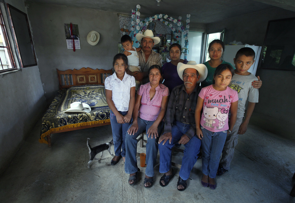 ADVANCE FOR USE FRIDAY, DEC. 23, 2016 AND THEREAFTER-In this July 15, 2016 photo, the parents and siblings of late Jose Rangel Chavez p...