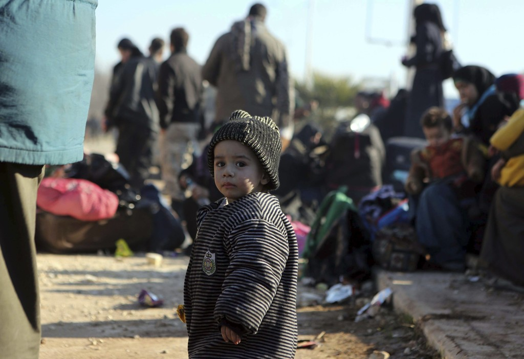 A young Syrian child evacuated from the embattled Syrian city of Aleppo during the ceasefire arrives at a refugee camp in Rashidin, nea...