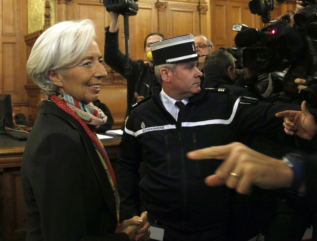 FILE - In this Monday, Dec. 12, 2016 file picture, International Monetary Fund chief Christine Lagarde, right, arrives at the special P...