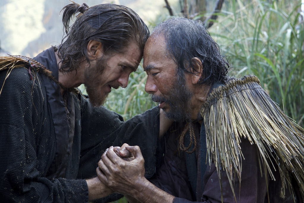 """This image released by Paramount Pictures shows Andrew Garfield, left, and Shinya Tsukamoto in a scene from """"Silence."""" (Kerry Brown/Par..."""