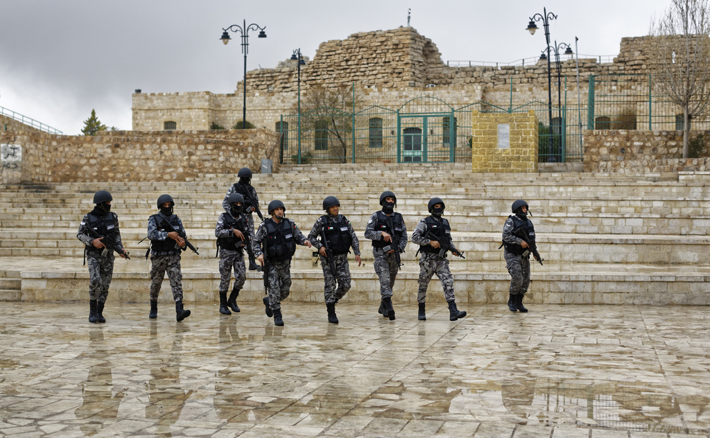 Jordanian security forces patrol in front of Karak Castle in the central town of Karak, about 140 kilometers (87 miles) south of the ca...