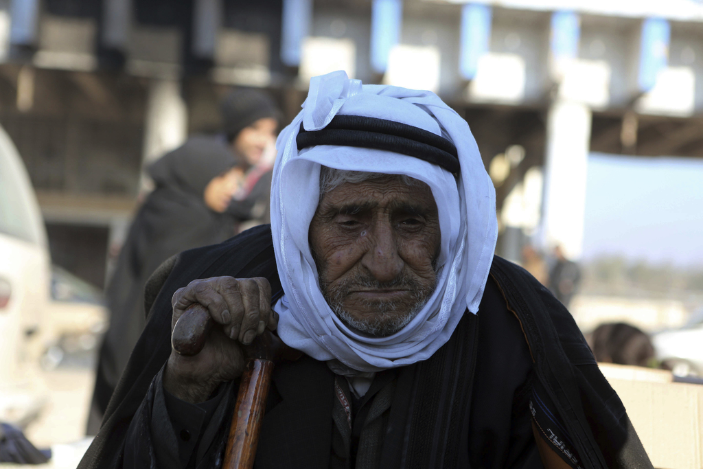 A old Syrian man evacuated from the embattled Syrian city of Aleppo during the ceasefire arrives at a refugee camp in Rashidin, near Id...