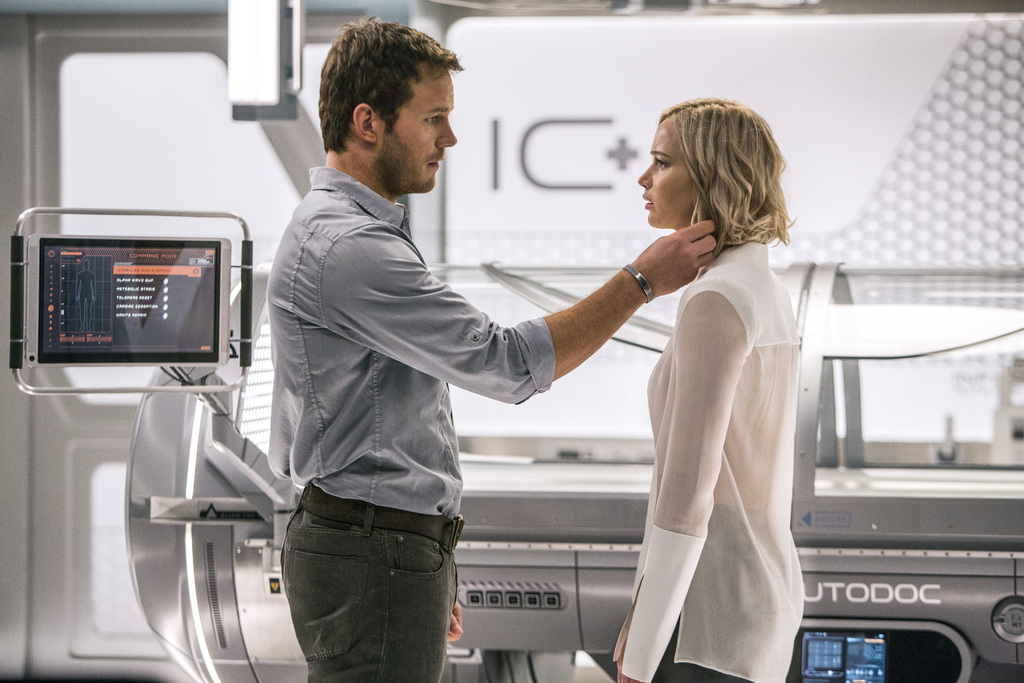 """This image released by Columbia Pictures, Chris Pratt, left, and Jennifer Lawrence in a scene from the film, Passengers."""" (Jaimie Trueb..."""