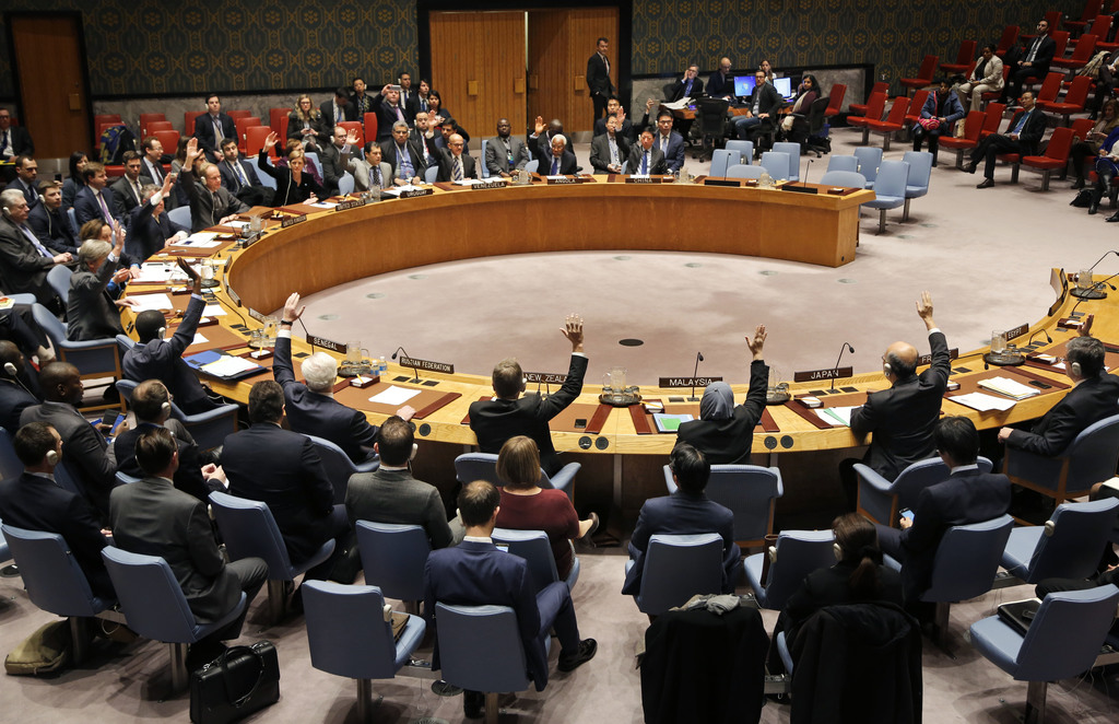 The U.N. Security Council votes unanimously to adopt a resolution concerning humanitarian aid in Syria at United Nations headquarters, ...