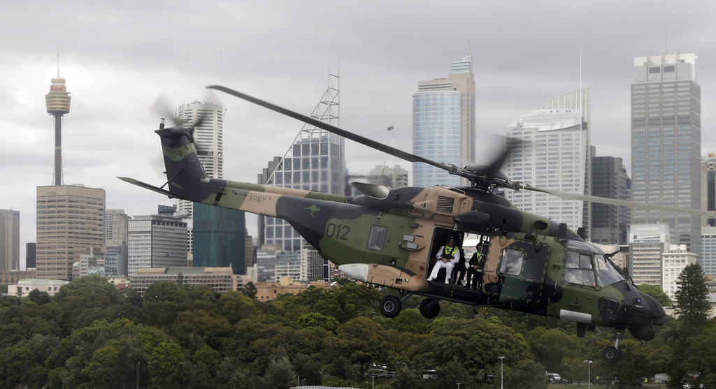 An Australian Army helicopter flies French Defense Minister Jean-Yves Le Drian, right, over Sydney Harbour before his bilateral meeting...