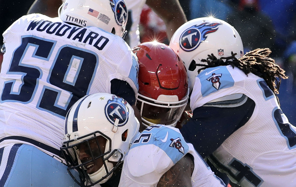 Tennessee Titans linebacker Wesley Woodyard (59), linebacker Avery Williamson, center bottom, and safety Daimion Stafford (24) prevent ...