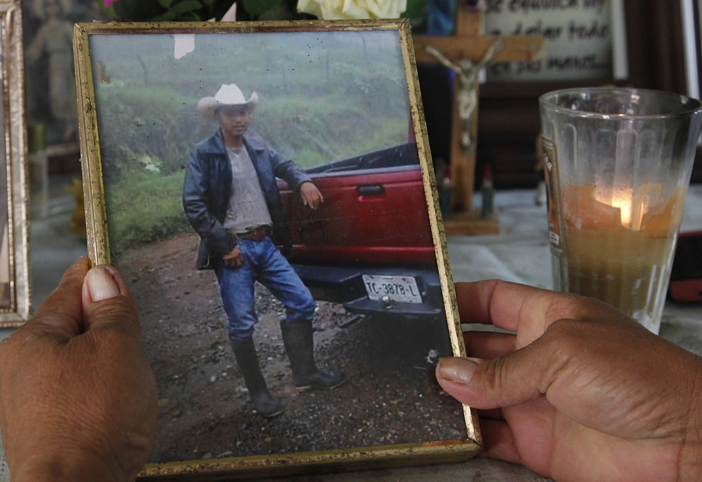 ADVANCE FOR USE FRIDAY, DEC. 23, 2016 AND THEREAFTER-In this July 15, 2016 photo, Maria Felix Martinez Chavez holds a photo of her late...