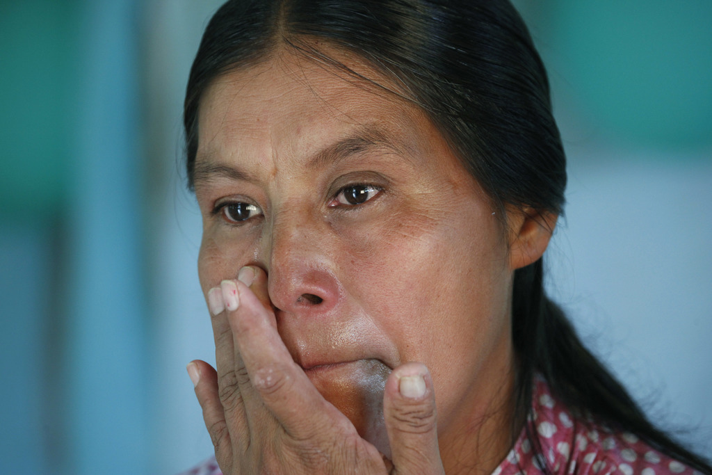 ADVANCE FOR USE FRIDAY, DEC. 23, 2016 AND THEREAFTER-In this July 15, 2016 photo, Maria Felix Martinez Chavez wipes away tears during a...