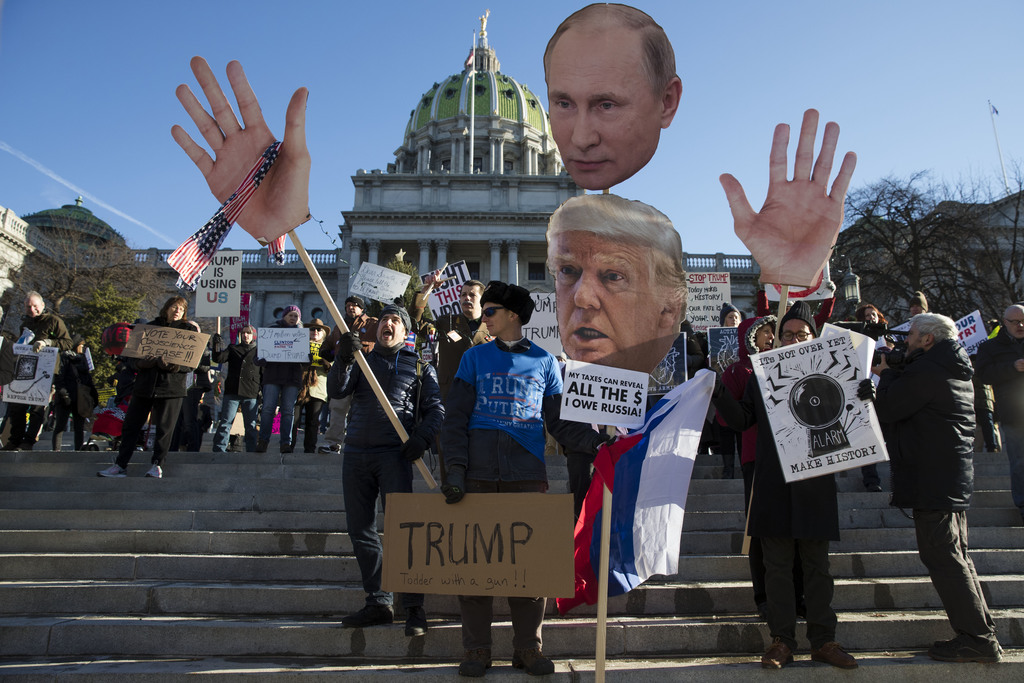 Protesters demonstrate ahead of Pennsylvania's 58th Electoral College at the state Capitol in Harrisburg, Pa., Monday, Dec. 19, 2016. T...