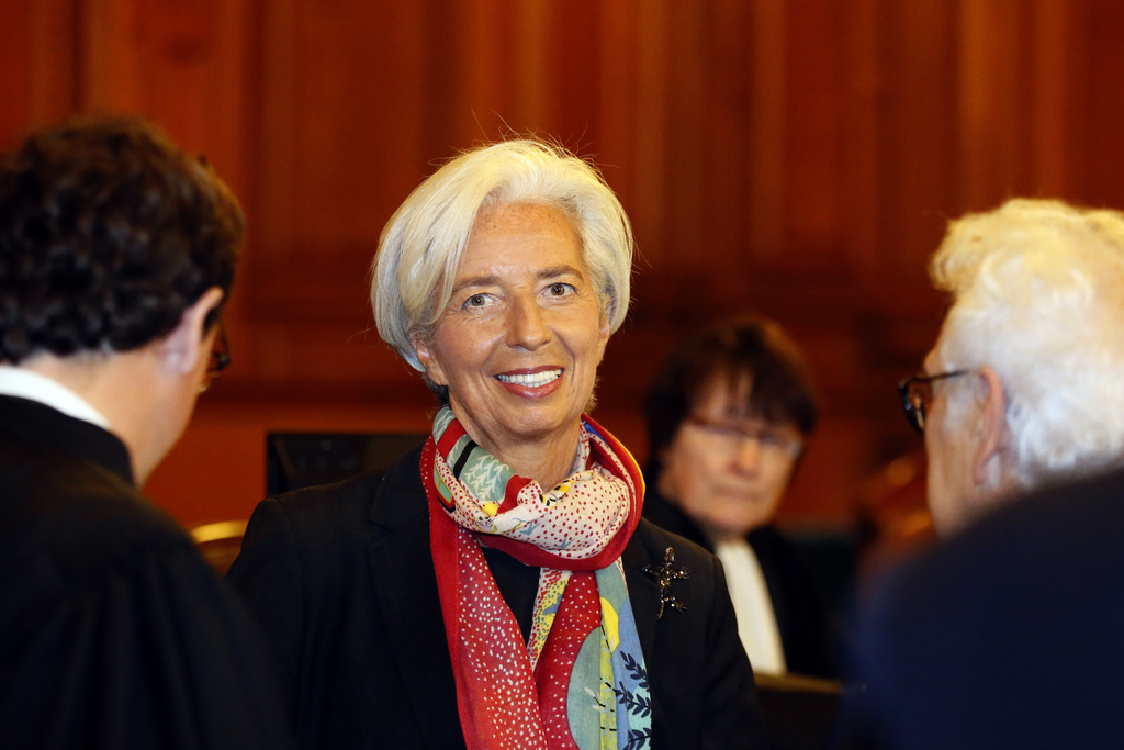 FILE - In this Monday, Dec.12, 2016 file picture, International Monetary Fund chief Christine Lagarde smiles as she arrives at the spec...
