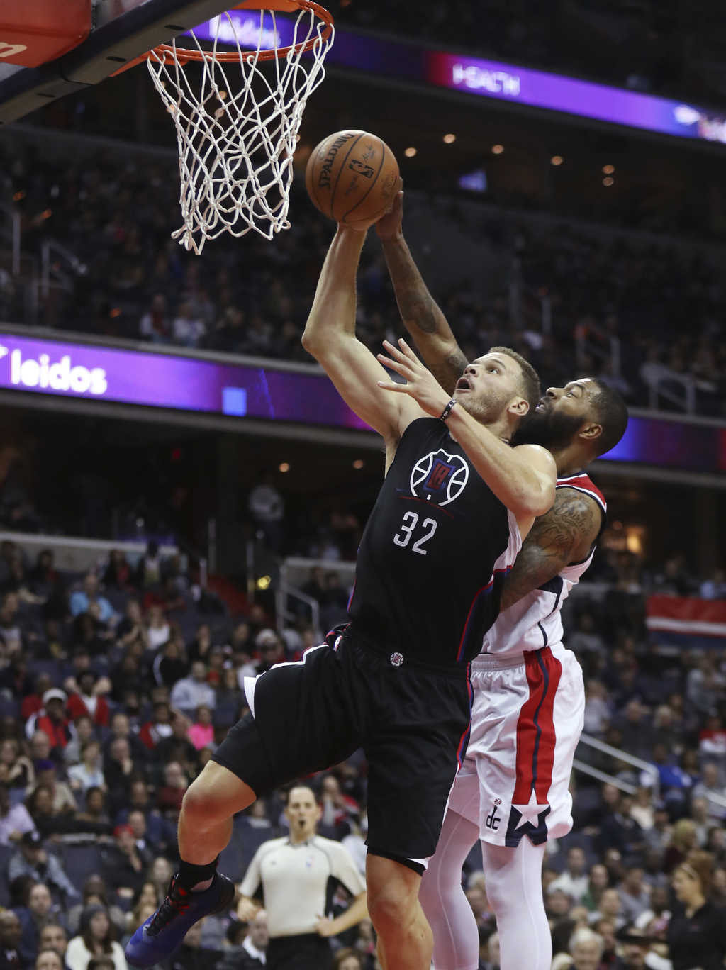 Los Angeles Clippers forward Blake Griffin (32) shoots and is fouled by Washington Wizards forward Markieff Morris, right, during the f...