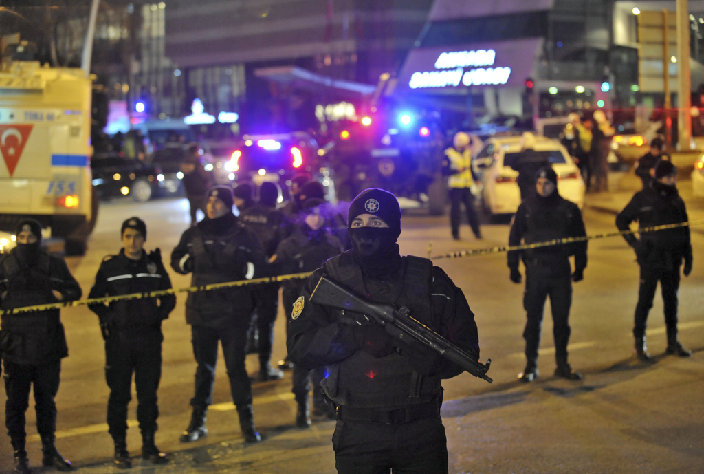Turkish police officers cordon off the area close to a photo gallery where the Russian Ambassador to Turkey, Andrei Karlov, was shot an...
