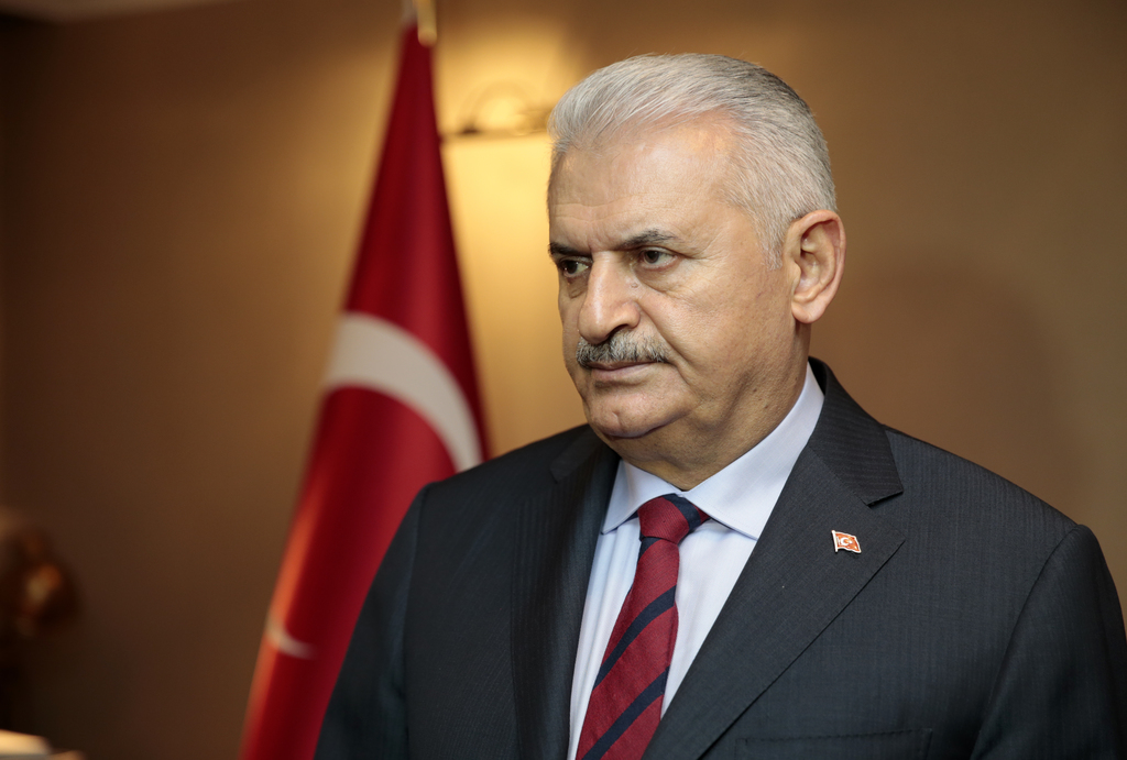 Turkey's Prime Minister Binali Yildirim,  pause as he comments onthe Russian ambassador Andrei Karlov's assassination earlier Monday, a...