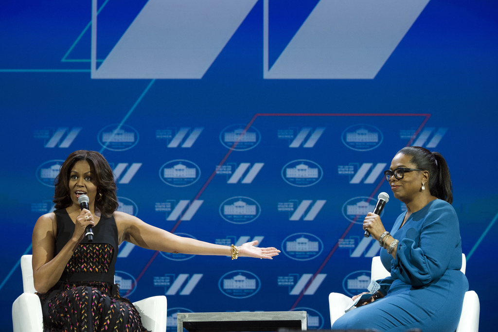FILE - In this  June 14, 2016, file photo, first lady Michelle Obama and Oprah Winfrey have a discussion on Trailblazing the Path for t...