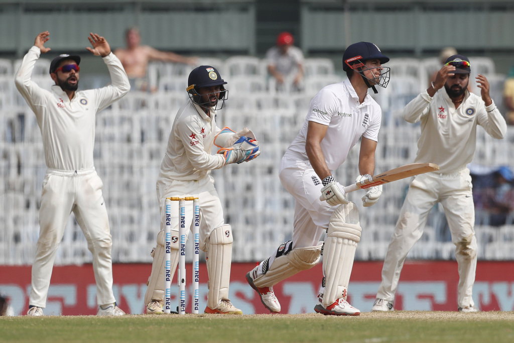 England's captain Alastair Cook, second right, watches a ball as India's captain Virat Kohli, first left, wicket keeper Parthiv Patel ,...