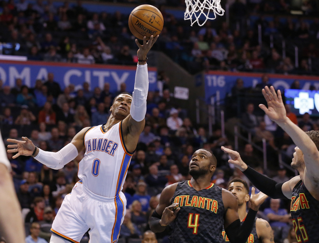 Oklahoma City Thunder guard Russell Westbrook (0) shoots in front of Atlanta Hawks forward Paul Millsap (4), forward Thabo Sefolosha, r...