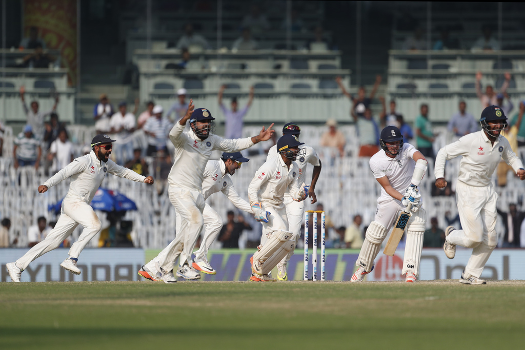 Indian cricket captain Virat Kohli, left, and team celebrate after winning the test series against England during their fifth day of th...