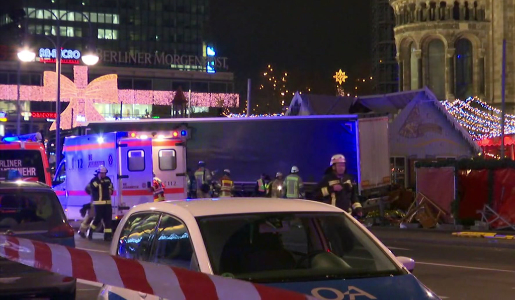 In this screen grab taken from video, emergency services attend the scene, after an attack by a truck at a Christmas market, in Berlin,...