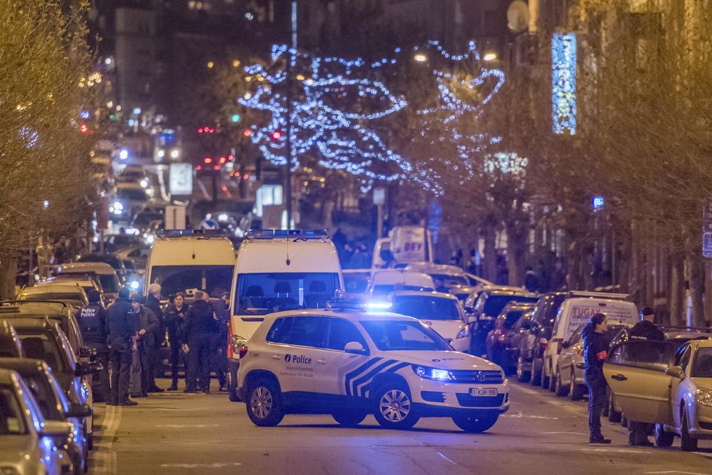 Police search an area in the Schaerbeek neighborhood in Brussels on Monday, Dec. 19, 2016. (AP Photo/Geert Vanden Wijngaert)           ...