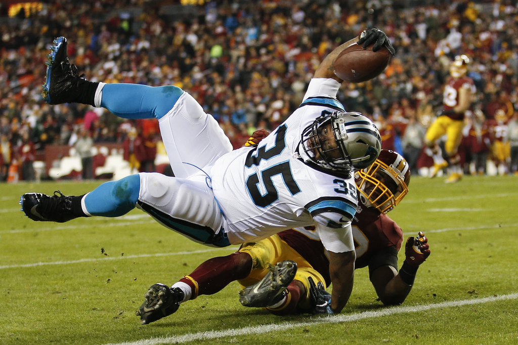 Carolina Panthers fullback Mike Tolbert (35) rolls over Washington Redskins outside linebacker Martrell Spaight (50) for a touchdown du...