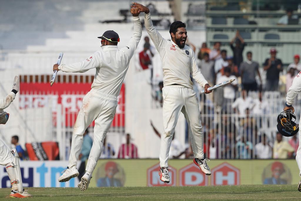 Indian cricket captain Virat Kohli, left, and teammate Ravindra Jadeja celebrate after wining the test series against England during th...