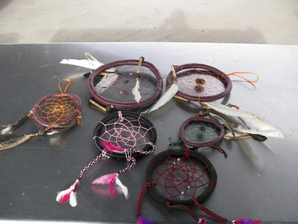 This Sunday, Dec. 18, 2016 photo provided by the U.S. Customs and Border Protection shows dreamcatchers filled with liquid methamphetam...
