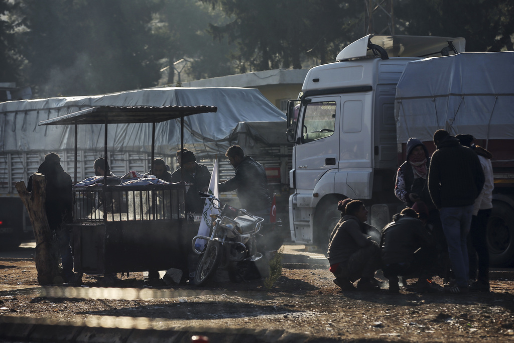 People wait at the Cilvegozu border gate with Syria, near Hatay, southeastern Turkey, Monday, Dec, 19, 2016. United Nations' Security C...