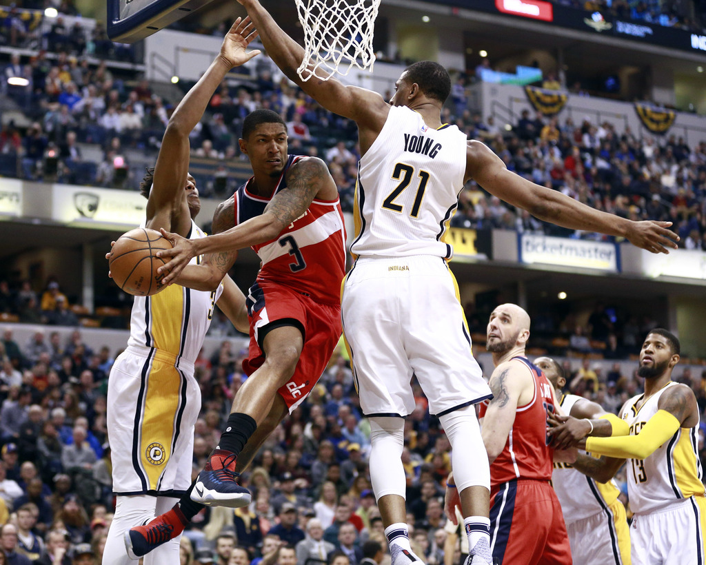 Washington Wizards guard Bradley Beal (3) passes the basketball defended by Indiana Pacers center Myles Turner, left, and Pacers forwar...