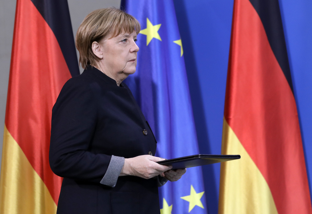 German Chancellor Angela Merkel arrives for a statement at the chancellery in Berlin, Germany, Tuesday, Dec. 20, 2016 the day after a t...