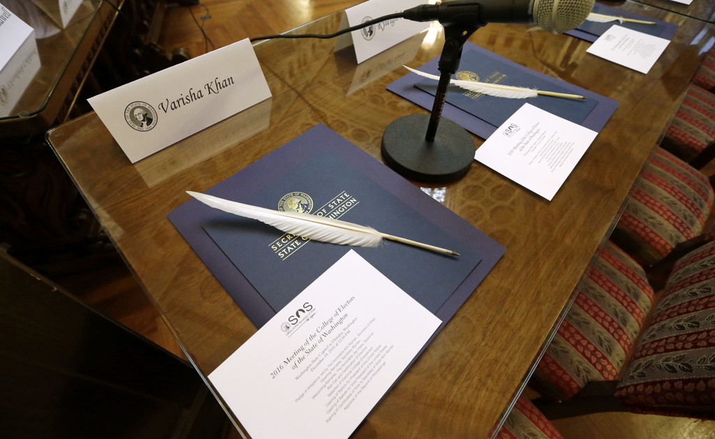 Quill ballpoint pens sit ready for Elector College electors, Monday, Dec. 19, 2016, in Olympia, Wash. Members of Washington state's Ele...