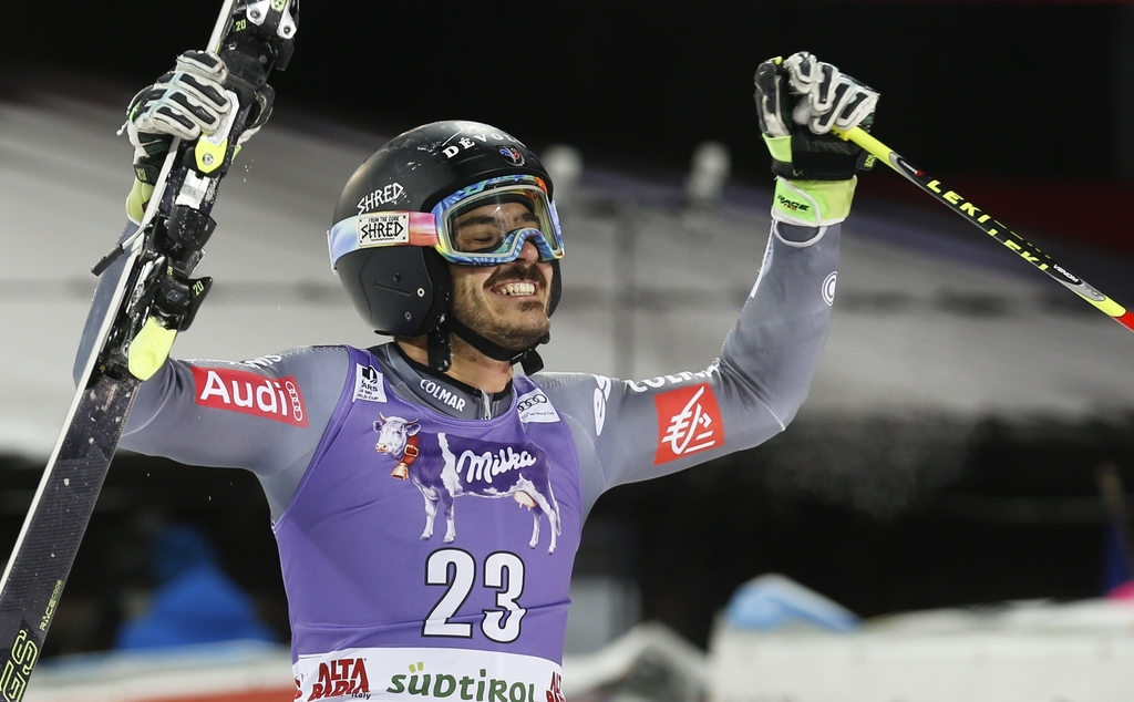 France's Cyprien Sarrazin celebrates after winning an alpine ski, men's World Cup giant slalom, in Alta Badia Italy, Sunday Dec. 18, 20...