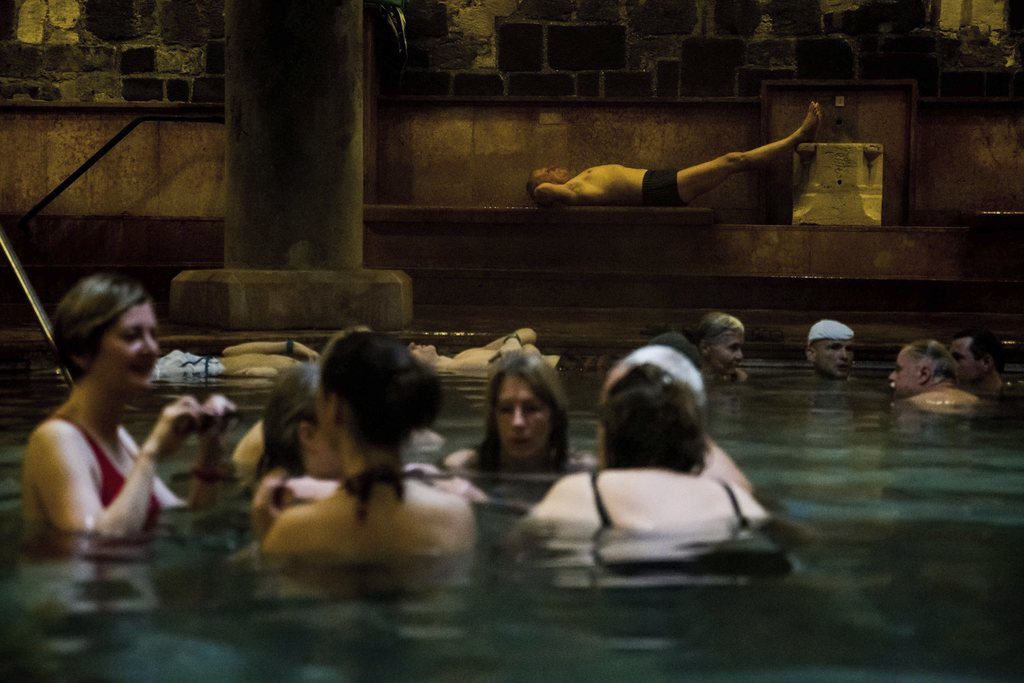 FILE - In this March 20, 2016 file photo visitors chat in a pool of Rudas Thermal Bath and Swimming Pool in Budapest, Hungary. The city...