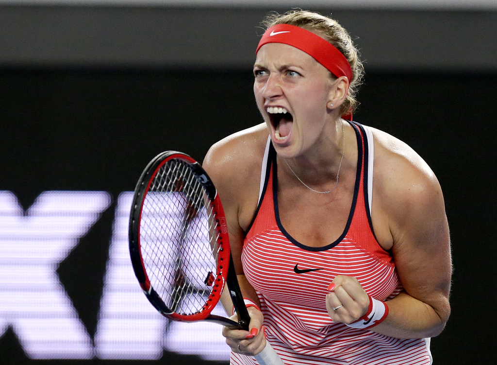 FILE - This is a Wednesday, Jan. 20, 2016 file photo of Petra Kvitova of the Czech Republic, clenches her left hand as she reacts after...