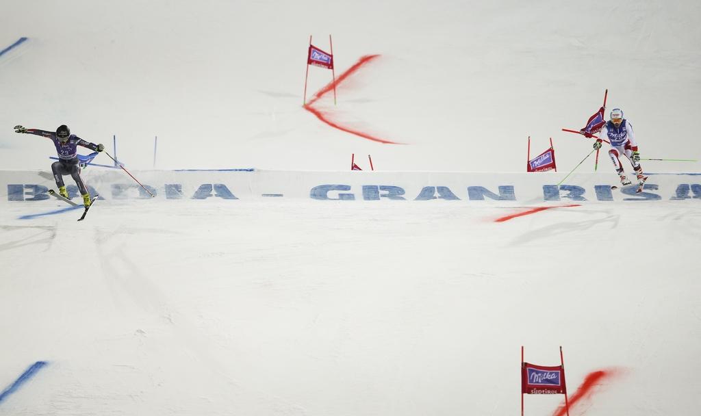 France's Cyprien Sarrazin, left, competes alongside Switzerland's Carlo Janka on his way to win an alpine ski, men's World Cup giant sl...