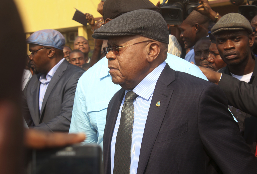 FILE - In this Wednesday, July 27, 2016 file photo, Congo's largest opposition party leader Etienne Tshisekedi, center, is greeted by s...