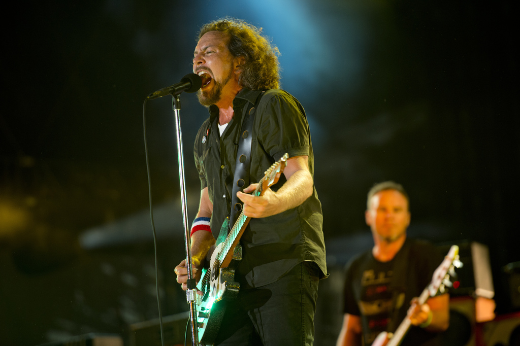 """FILE - In this Sept. 2, 2012, file photo, Pearl Jam performs at the """"Made In America"""" music festival in Philadelphia. The Seattle-based..."""