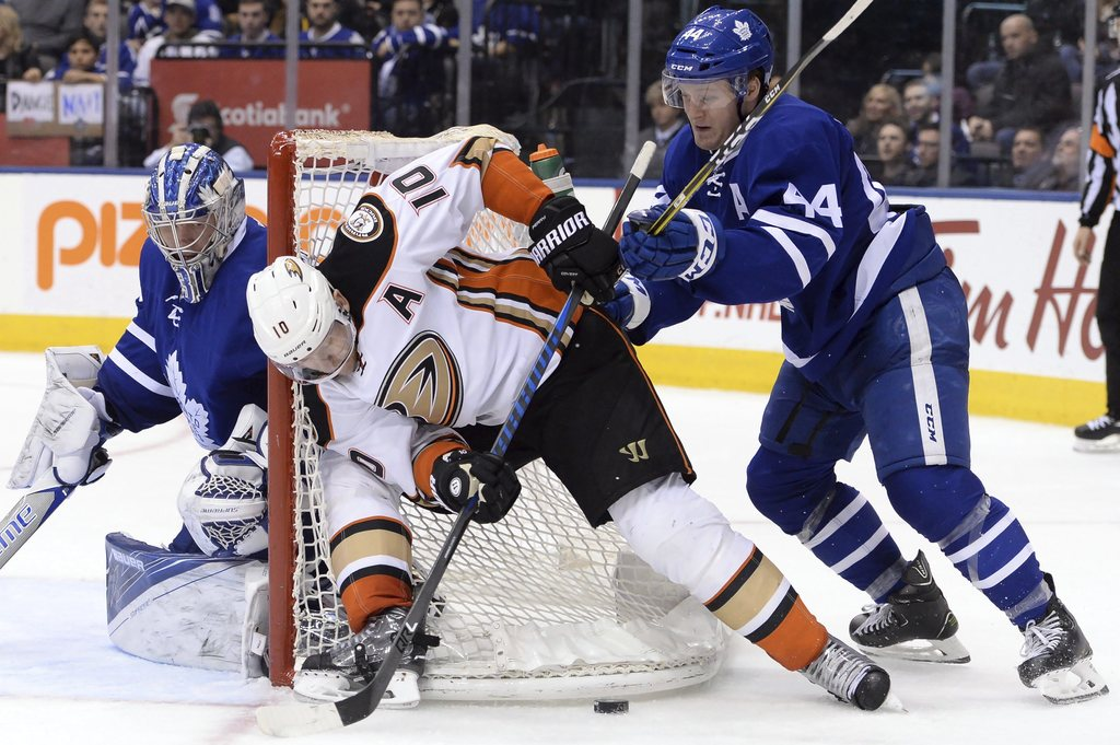 Anaheim Ducks right wing Corey Perry (10) plays the puck by the side of the net as Toronto Maple Leafs goalie Frederik Andersen (31) lo...