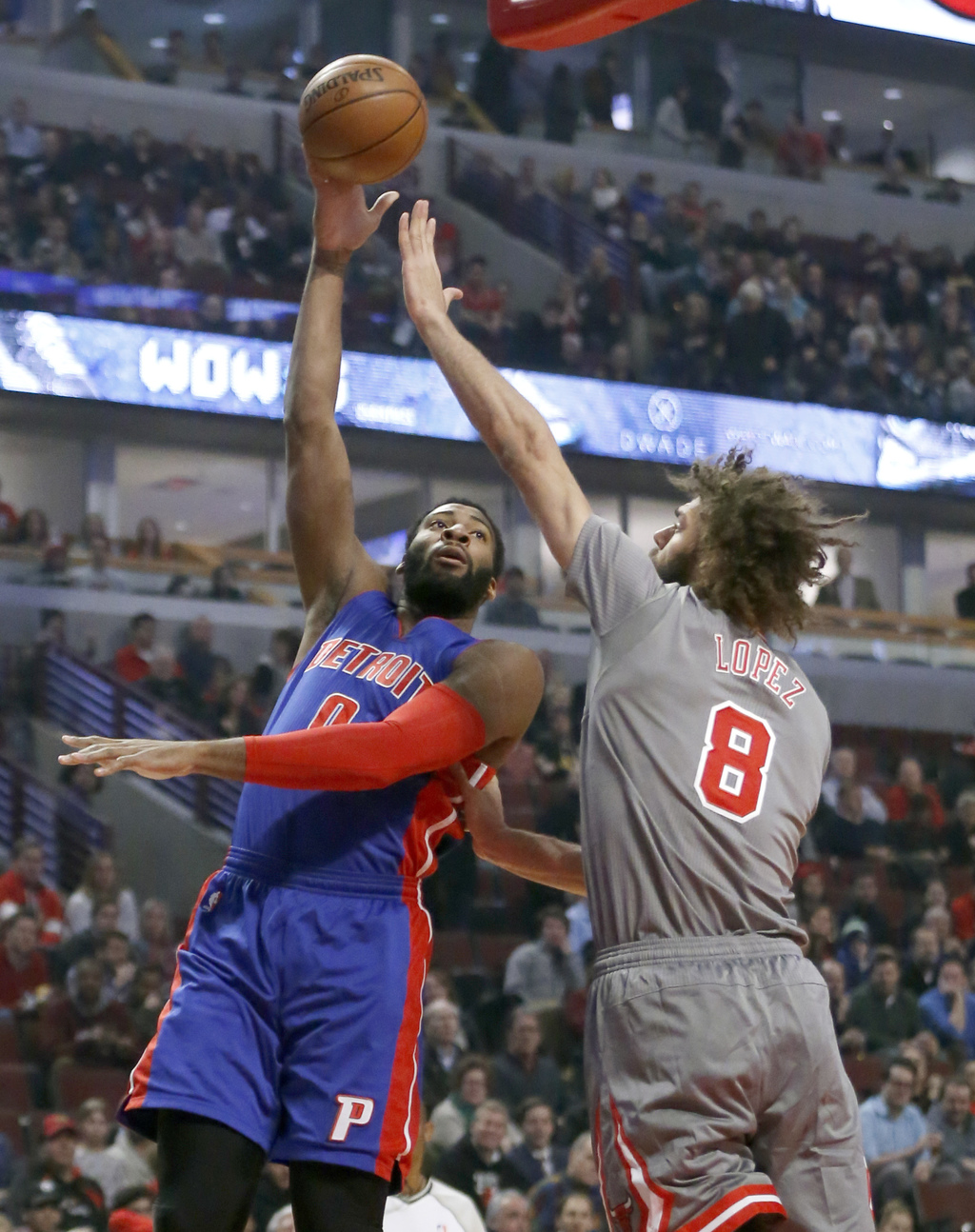 Detroit Pistons' Andre Drummond, left, shoots over Chicago Bulls' Robin Lopez during the first half of an NBA basketball game Monday, D...