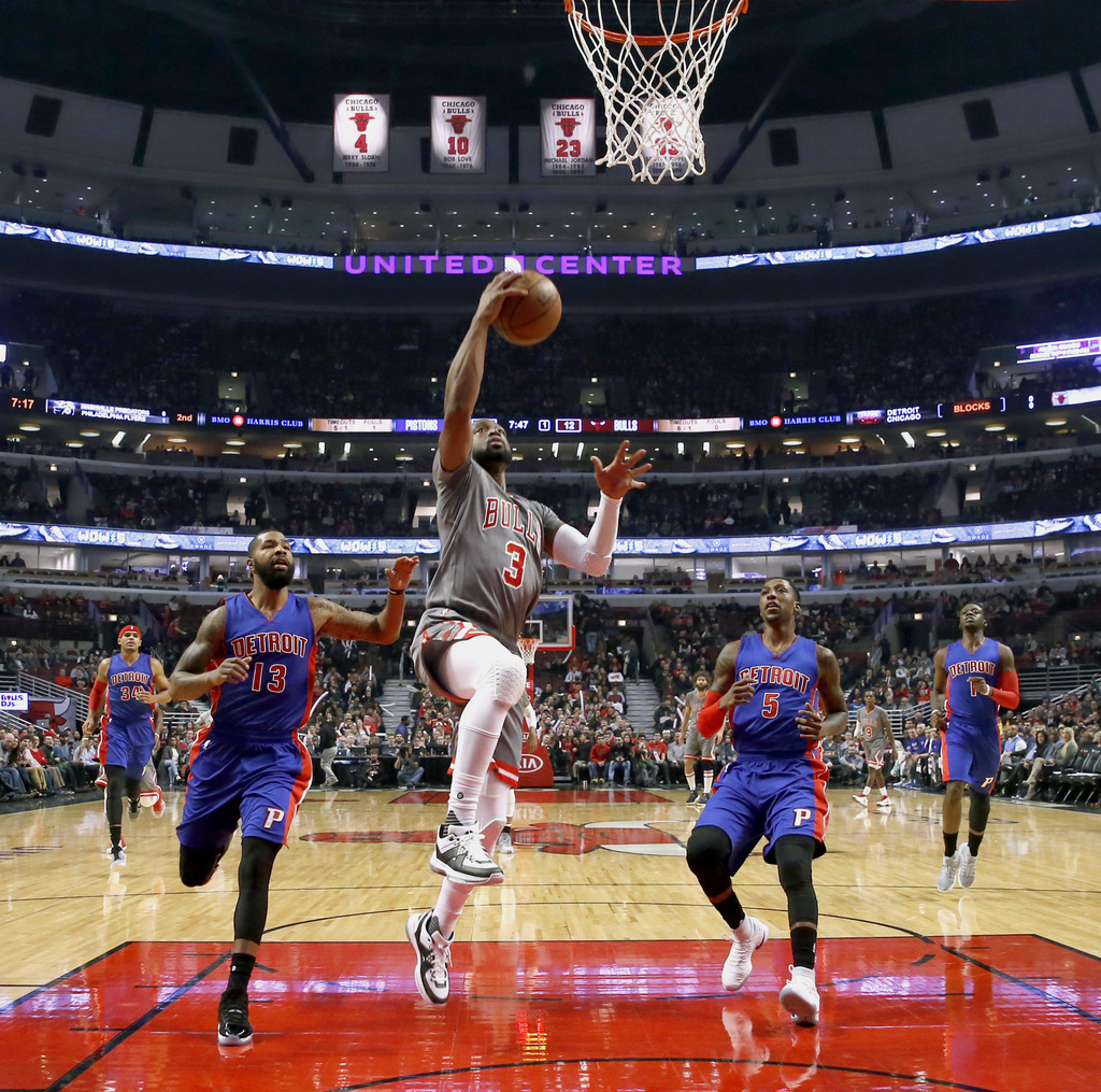 Chicago Bulls' Dwyane Wade (3) scores past Detroit Pistons' Marcus Morris (13) and Kentavious Caldwell-Pope during the first half of an...