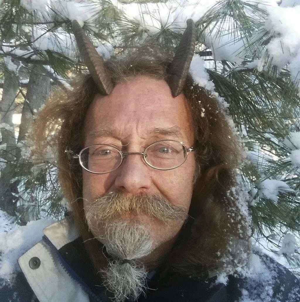 This Dec. 7, 2016, photo provided by Phelan Moonsong shows a portrait of himself in Portland, Maine. Moonsong, an ordained Pagan priest...
