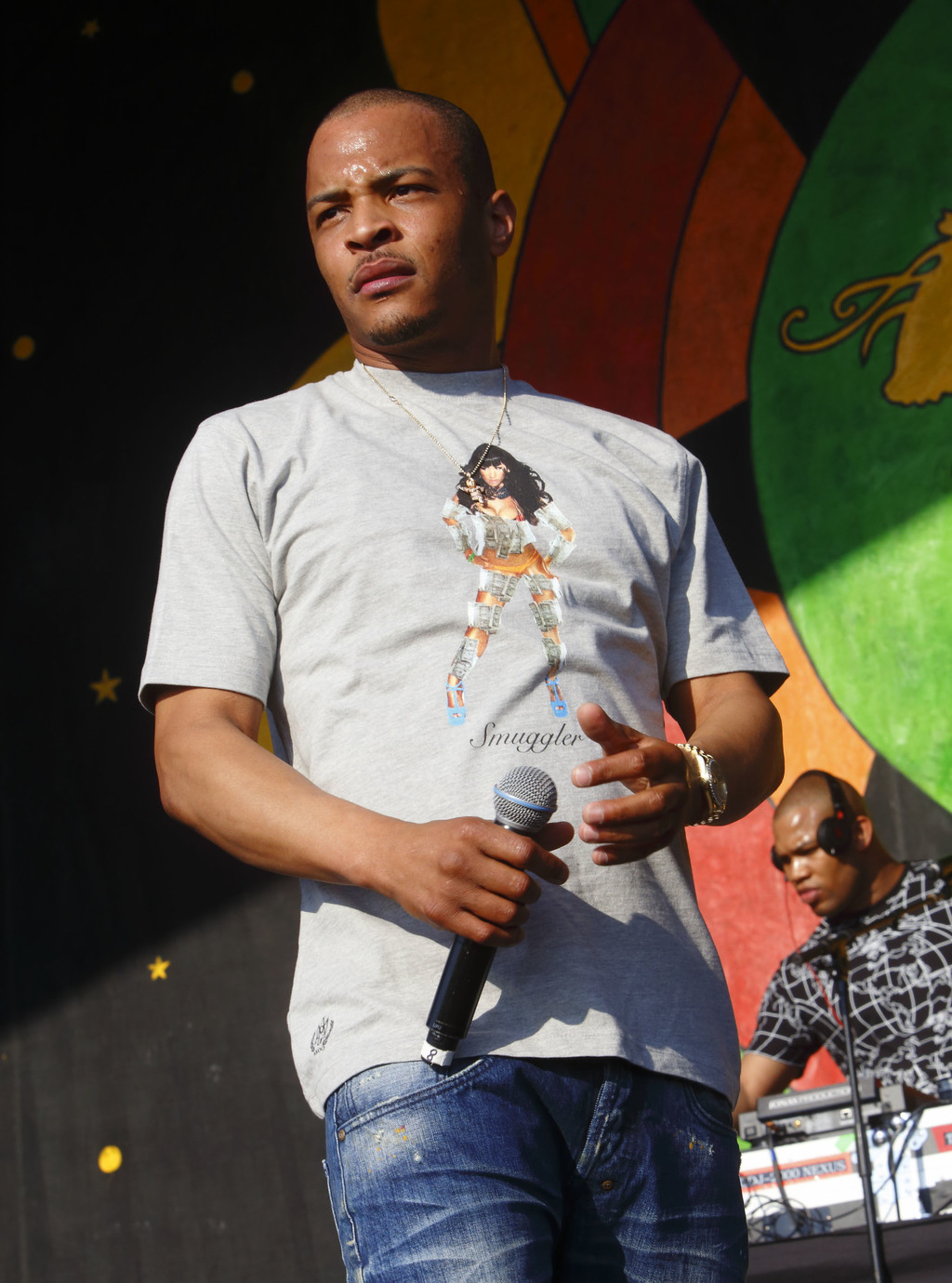 FILE - This May 2, 2015 file photo shows T. I. performing at the New Orleans Jazz & Heritage Festival in New Orleans. Motivated by the ...